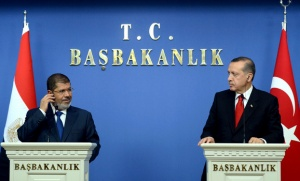 Turkey's Prime Minister Erdogan and Egypt's President Mursi attend a news conference in Ankara