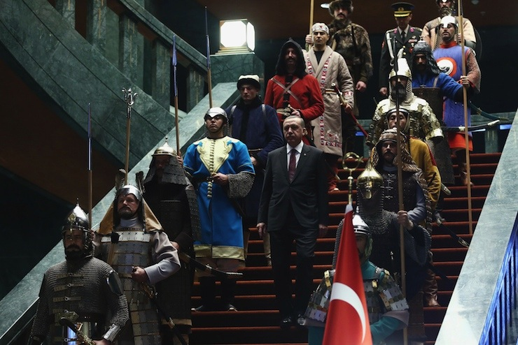 Turkey's President Tayyip Erdogan walks down the stairs in between soldiers as he arrives for a welcoming ceremony for Palestinian President Mahmoud Abbas at the Presidential Palace in Ankara